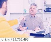 Купить «Mature man and agent sign rental agreement», фото № 25765493, снято 24 февраля 2019 г. (c) Яков Филимонов / Фотобанк Лори