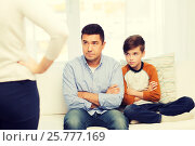 Купить «upset or displeased father, son and mother at home», фото № 25777169, снято 24 октября 2015 г. (c) Syda Productions / Фотобанк Лори