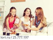 Купить «happy friends or teen girls eating pizza at home», фото № 25777197, снято 14 ноября 2015 г. (c) Syda Productions / Фотобанк Лори