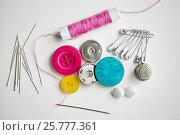 Купить «sewing buttons, needles, pins and thread spool», фото № 25777361, снято 29 сентября 2016 г. (c) Syda Productions / Фотобанк Лори