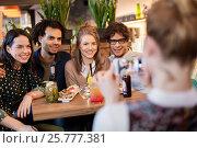 Купить «friends with smartphone photographing at cafe», фото № 25777381, снято 19 ноября 2016 г. (c) Syda Productions / Фотобанк Лори