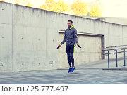 Купить «man exercising with jump-rope outdoors», фото № 25777497, снято 17 октября 2015 г. (c) Syda Productions / Фотобанк Лори