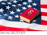 Купить «close up of american flag and lawbook», фото № 25777577, снято 30 июня 2016 г. (c) Syda Productions / Фотобанк Лори
