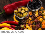 Plate with olives, pasta, sweet and bitter peppers. Ingredients for Italian dishes. Close-up. Стоковое фото, фотограф Татьяна Дубчук / Фотобанк Лори