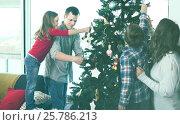 Купить «Cheerful family members preparing for Christmas», фото № 25786213, снято 23 декабря 2016 г. (c) Яков Филимонов / Фотобанк Лори