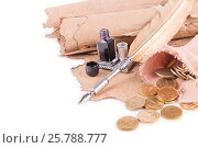 Coins, pen and ancient manuscripts on a white background. Стоковое фото, фотограф Владимир Ковальчук / Фотобанк Лори