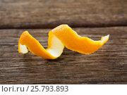 Купить «Close-up of spiral orange peel», фото № 25793893, снято 19 декабря 2016 г. (c) Wavebreak Media / Фотобанк Лори