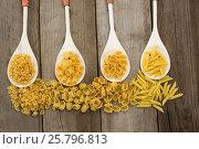 Купить «Spoons filled with varieties of pasta», фото № 25796813, снято 13 октября 2016 г. (c) Wavebreak Media / Фотобанк Лори