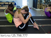 Купить «Women performing stretching exercise», фото № 25798777, снято 7 октября 2016 г. (c) Wavebreak Media / Фотобанк Лори