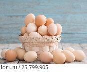 Купить «eggs on blue wooden background», фото № 25799905, снято 12 марта 2017 г. (c) Майя Крученкова / Фотобанк Лори