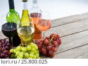 Купить «Bunches of various grapes with wine glass and bottles», фото № 25800025, снято 19 декабря 2016 г. (c) Wavebreak Media / Фотобанк Лори