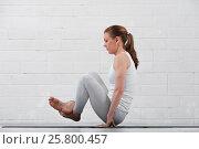 Купить «Flexible woman practicing high level yoga indoors», фото № 25800457, снято 12 марта 2017 г. (c) Pavel Biryukov / Фотобанк Лори