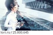 Купить «Attractive business lady working on tablet . Mixed media», фото № 25800645, снято 25 марта 2014 г. (c) Sergey Nivens / Фотобанк Лори