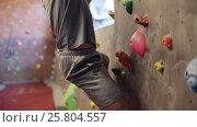 Купить «young man exercising at indoor climbing gym wall», видеоролик № 25804557, снято 2 марта 2017 г. (c) Syda Productions / Фотобанк Лори