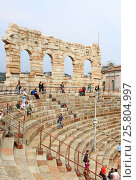 Купить «VERONA, ITALY - SEPTEMBER 3, 2012: The Verona Arena (Arena di Verona) is a Roman amphitheatre on Piazza Bra in Verona», фото № 25804997, снято 3 сентября 2012 г. (c) Шилер Анастасия / Фотобанк Лори