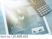 Купить «Graph with calculator and pencil», фото № 25808433, снято 23 июля 2019 г. (c) Wavebreak Media / Фотобанк Лори
