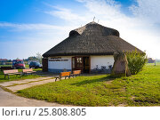 Купить «HORTOBAGY, HUNGARY - OCTOBER 31, 2015: Ethnographical museum in Hortobagy National Park, Hungary. The round-shaped building exhibits craftsmanship characteristic of the Hortobágy in living pictures», фото № 25808805, снято 31 октября 2015 г. (c) Papoyan Irina / Фотобанк Лори