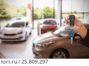 Купить «Composite image of woman holding key and small car», фото № 25809297, снято 21 февраля 2020 г. (c) Wavebreak Media / Фотобанк Лори