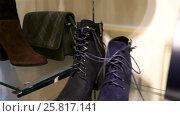 Купить «Sale collection of footwear and accessories with discount 50 percent», видеоролик № 25817141, снято 3 февраля 2017 г. (c) Курганов Александр / Фотобанк Лори