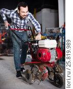 Working man practicing his skills and using plough. Стоковое фото, фотограф Яков Филимонов / Фотобанк Лори