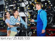 Купить «Portrait man and woman sitting on motorbike and chatting with mechanic man», фото № 25820133, снято 7 июня 2020 г. (c) Яков Филимонов / Фотобанк Лори