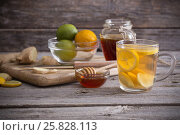 Ginger tea and ingredients on a grunge wooden background. Стоковое фото, фотограф Майя Крученкова / Фотобанк Лори