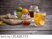 Купить «Ginger tea and ingredients on a grunge wooden background», фото № 25828113, снято 23 марта 2017 г. (c) Майя Крученкова / Фотобанк Лори