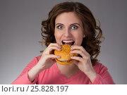 young beautiful girl disdainfully holding a junk food from fast food sandwich. Стоковое фото, фотограф Анатолий Типляшин / Фотобанк Лори