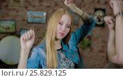 Купить «Happy and attractive young couple dance together», видеоролик № 25829125, снято 10 марта 2017 г. (c) Илья Насакин / Фотобанк Лори