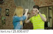 Купить «Happy and attractive young couple dance together», видеоролик № 25830617, снято 10 марта 2017 г. (c) Илья Насакин / Фотобанк Лори