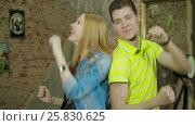 Купить «Happy and attractive young couple dance together», видеоролик № 25830625, снято 10 марта 2017 г. (c) Илья Насакин / Фотобанк Лори