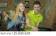 Купить «Happy and attractive young couple dance together», видеоролик № 25830629, снято 10 марта 2017 г. (c) Илья Насакин / Фотобанк Лори