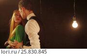 Happy and attractive young couple dance together. Стоковое видео, видеограф Илья Насакин / Фотобанк Лори