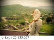 Купить «The young girl turned her back and looking at the amazingly beautiful mountain landscape», фото № 25833057, снято 10 апреля 2016 г. (c) Давидич Максим / Фотобанк Лори