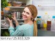 Купить «long-haired woman arranging space in fridge at home», фото № 25833329, снято 7 июля 2020 г. (c) Яков Филимонов / Фотобанк Лори