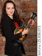 Купить «Pretty young woman hold mini guitar in studio with red brick wall», фото № 25836073, снято 9 февраля 2016 г. (c) Losevsky Pavel / Фотобанк Лори