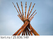 Купить «Tipi on blue sky background (Tipi - structure in shape of cone, which is based on multiple poles)», фото № 25836149, снято 13 июня 2014 г. (c) Losevsky Pavel / Фотобанк Лори