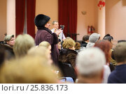 Купить «MOSCOW - JAN 21, 2015: Woman from auditorium asks a question at the meeting with the head of the district council Bogorodskoe, motion blur», фото № 25836173, снято 21 января 2015 г. (c) Losevsky Pavel / Фотобанк Лори