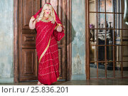 Купить «Barefoot blonde woman in red dress stand in room with two doors - solid and latticed», фото № 25836201, снято 17 сентября 2015 г. (c) Losevsky Pavel / Фотобанк Лори