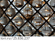 Купить «glass transparent balls hanging in metal lattice diamonds, ornamental decoration», фото № 25836237, снято 9 марта 2015 г. (c) Losevsky Pavel / Фотобанк Лори
