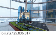 Купить «RUSSIA, KRASNOGORSK - DEC 12, 2014: The layout of modern building and infrastructure in the House of the Moscow Region Government and the same actually building under construction outside the window», фото № 25836317, снято 12 декабря 2014 г. (c) Losevsky Pavel / Фотобанк Лори