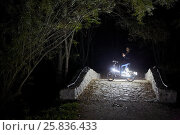 Купить «Woman with cell phone at night park on bicycle decorated with luminous diodes», фото № 25836433, снято 18 сентября 2015 г. (c) Losevsky Pavel / Фотобанк Лори