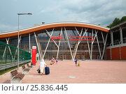 Купить «SOCHI, KRASNAYA POLYANA, RUSSIA - AUG 4, 2014: People (with MR) on modern railway station Rosa Khutor in Krasnaya Polyana», фото № 25836445, снято 4 августа 2014 г. (c) Losevsky Pavel / Фотобанк Лори