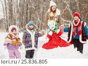 Купить «Four children of different age stand around stuffed dummy of Maslenitsa, sitting on snowbank in winter park», фото № 25836805, снято 25 января 2015 г. (c) Losevsky Pavel / Фотобанк Лори