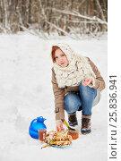 Купить «Teenage girl opens glass jar with honey near blue jug, glass cup with beverage, plate with pancakes on snow», фото № 25836941, снято 25 января 2015 г. (c) Losevsky Pavel / Фотобанк Лори