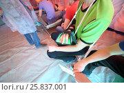 Купить «The injured man with a bandaged hand in a field hospital», фото № 25837001, снято 28 апреля 2015 г. (c) Losevsky Pavel / Фотобанк Лори