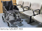 Купить «Wheel chair stands in lobby of hospital ready to transport patient», фото № 25837193, снято 19 марта 2015 г. (c) Losevsky Pavel / Фотобанк Лори