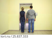 Купить «Man and woman in jeans stand near the elevator, view from the back», фото № 25837333, снято 1 мая 2015 г. (c) Losevsky Pavel / Фотобанк Лори