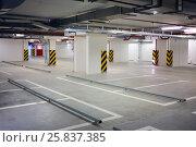 Купить «Interior underground parking for car, located under house, residential building», фото № 25837385, снято 21 июня 2014 г. (c) Losevsky Pavel / Фотобанк Лори