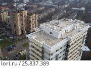 Купить «Roofs and surroundings with a high building in autumn», фото № 25837389, снято 28 октября 2014 г. (c) Losevsky Pavel / Фотобанк Лори